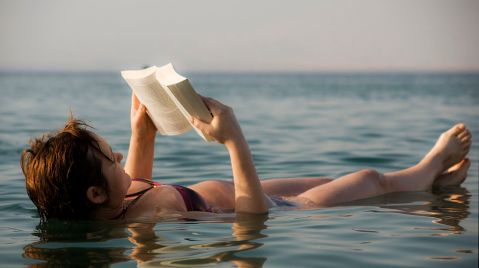 1024px-The_Dead_Sea_-_woman_reading_a_book